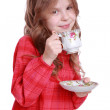 Little girl with a tea cup and sauce — Stock Photo #43970101