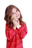 Little girl holding lovely angel doll — Stock Photo