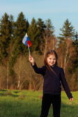 Patriotic little girl holding Russian flag — Stock Photo