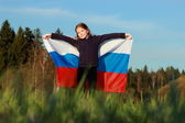 Beautiful little girl with Russian flag — Stock Photo