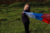 Girl holding a large Russian flag — Stock Photo