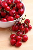 Sweet cherries in white bowl — Stock Photo