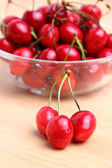 Sweet cherries in glass bowl — Stock Photo