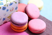 Five sweet colorful macaroons and paper decorative box — Stok fotoğraf