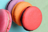 Four Tasty sweet colorful macarons — Stock Photo