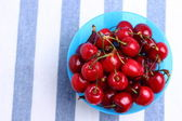 Bowl of fresh delicious red cherries — Stock Photo