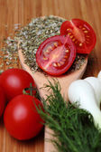 Ripe fresh tomatoes and herbs — Stock Photo
