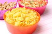 Raw macaroni in bowl — Stock Photo