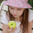 Beautiful little girl with green apple — Stock Photo #51569521