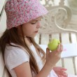Beautiful little girl with green apple — Stock Photo #51569525