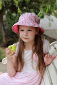 Beautiful little girl with green apple — Stock Photo