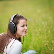 Portrait of a pretty young woman listening to music — Stock Photo #10408456