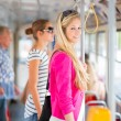 Pretty, young woman on a streetcar/tramway — Стоковая фотография