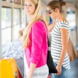 Pretty, young woman on a streetcar/tramway — ストック写真