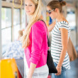Pretty, young woman on a streetcar/tramway — Stock fotografie