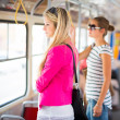 Pretty, young woman on a streetcar/tramway — Stock Photo