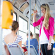 Pretty, young woman on a streetcar/tramway — Stock Photo #12427946