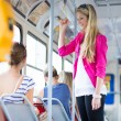 Pretty, young woman on a streetcar/tramway — Stock Photo #12427959