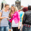 Two female tourists walking along the Charles Bridge — Stock Photo #12427977