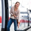 Pretty young woman boarding a train — Stock Photo #12428008