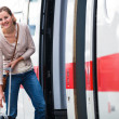 Pretty young woman boarding a train — Stock Photo #12428033