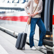 Pretty young woman boarding a train — Stock Photo #12428035