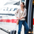 Pretty young woman boarding a train — Stock Photo #12428049