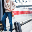 Pretty young woman boarding a train — Stock Photo #12428052