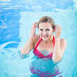 Portrait of a young woman relaxing in a swimming pool — Stock Photo