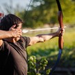 Young archer training with bow — Stock Photo #12428241