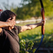 Young archer training with the bow — Stock Photo