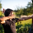 Young archer training with the  bow - Stock Photo