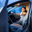 Pretty young woman driving her brand new car — Stock Photo