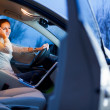 Pretty young woman driving her brand new car — Stock Photo #12428320