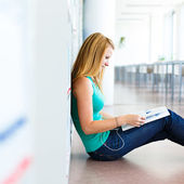 Pretty young college student in a library — Stock Photo