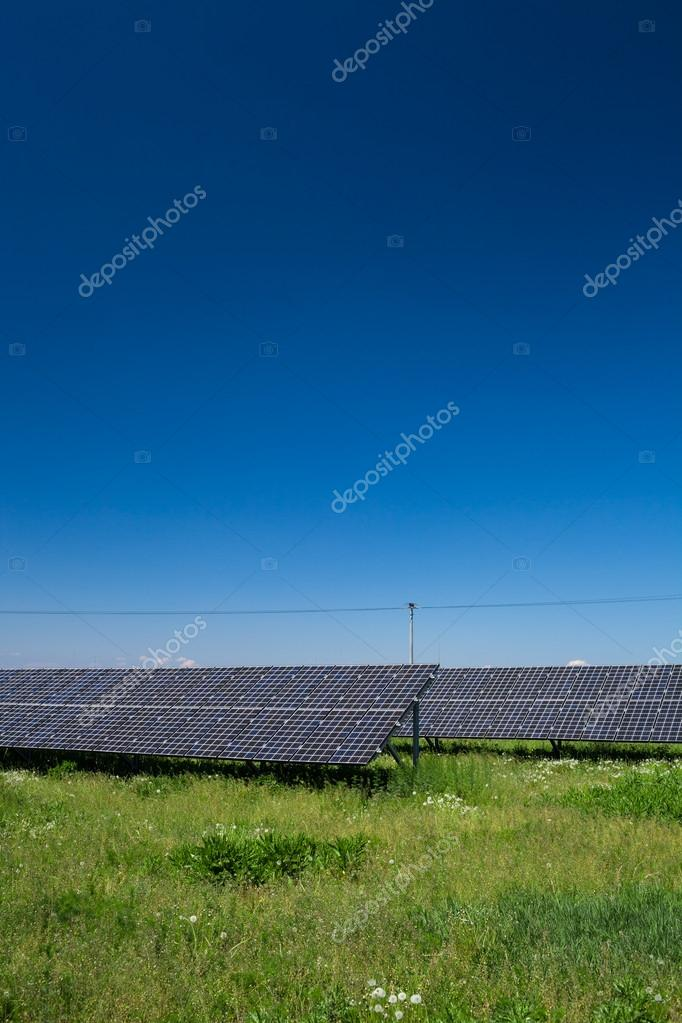 Sunlight as a resource of renewable energy: solar panels on a sunny day — Stock Photo #12427607