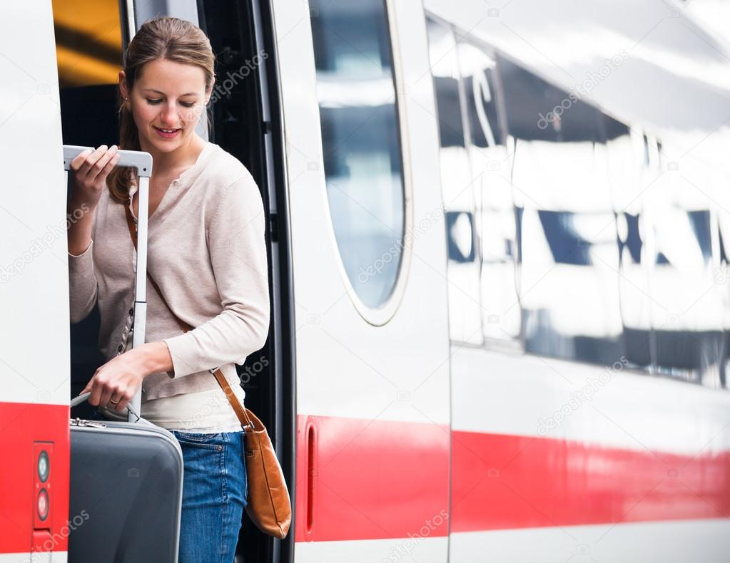 Pretty young woman boarding a train — Stock Photo #12427986
