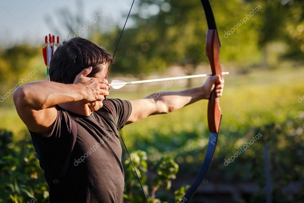 Young archer training with the  bow — Stock Photo #12428241