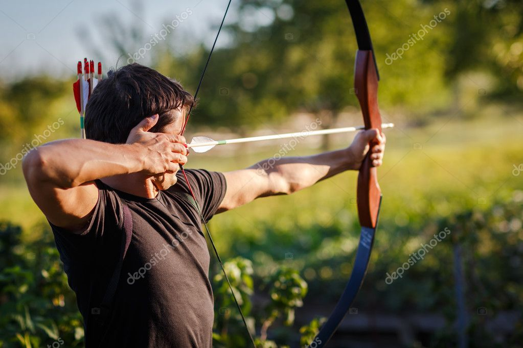 Young archer training with the  bow — Stok fotoğraf #12428241