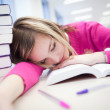 In the library - very tired, exhausted, pretty, female student — Stock Photo #12663461