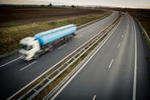 Highway traffic - motion blurred truck on a highway — Stock Photo