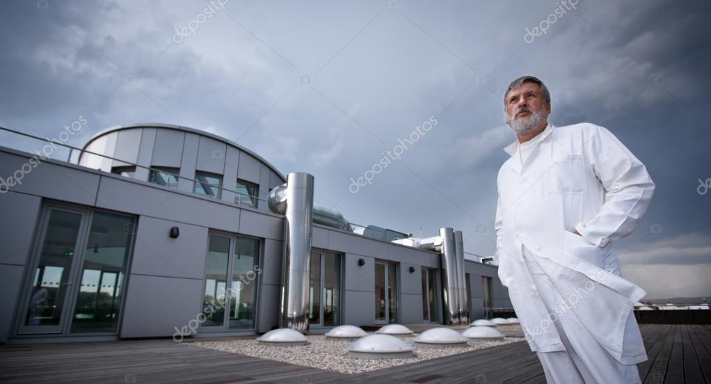 Renowned scientist or doctor standing on the roof of the research center or hospital looking confident (color toned image)  Stock Photo #12663542