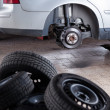 Stock Photo: Inside garage - changing wheels and tires