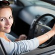 Pretty young woman driving her new car — Stock Photo #17128877