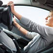 Pretty young woman driving her new car — Stock Photo #17128889