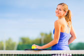 Portrait of a pretty young tennis player with copyspace — Stock Photo