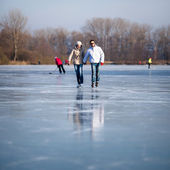 Couple ice skating outdoors on a pond on a lovely sunny winter day — Stock Photo