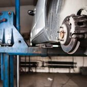 Inside a garage - changing wheels and tires — Stock Photo