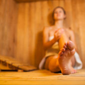 Young woman relaxing in a sauna — Foto de Stock