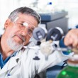 Senior male researcher carrying out scientific research in a lab — Stock Photo #18534977